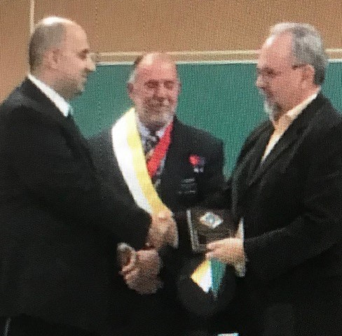"""Accompanied by the District Deputy, GK Bro. Roger Khouri presents the """"Knight of the Year"""" award to Bro. Dave Houghton."""