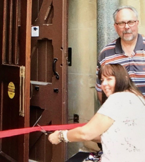 Cutting the ribbon on the newly installed automatic door opener in the west transept, a gift to the parish sponsored by our council.