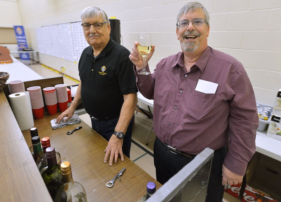 Bros Bob Holmes and James Vollmer tending bar at the Elimination Draw.