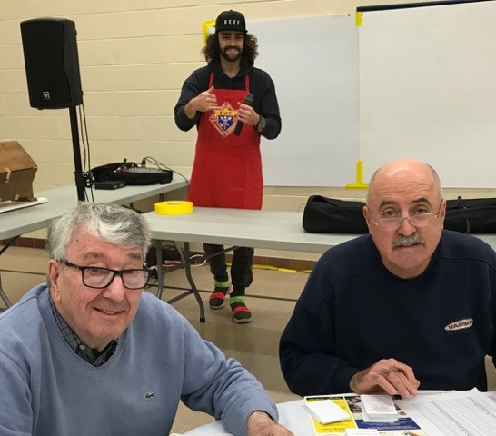 Bro. Juan, our newest Knight, checking on the sound system (two thumbs up... looks like we're good to go!) Bros. Joe Tornabuono & Pat Hogan in the foreground, double checking tickets.