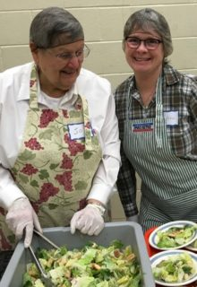 Working together with the ladies from the CWL: all smiles as they keep the salad bowls fresh.