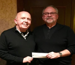 We were happy to offer our parish a cheque for $1600 as half of the proceeds of the Elimination Draw.  Santa Dave Houghton presented the cheque to Fr. Jim at that event too.