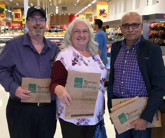 Bro. James Vollmer and his wife, Janice, along with Bro. George De Sousa pitching with the council's efforts to help the London Food Bank.