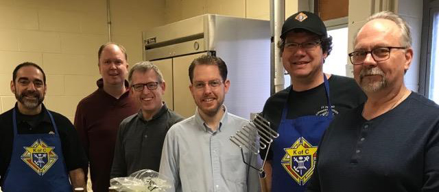 Winter Welcome Lunch: Bros. Joe Malheiro, Michael Butler, Jaye Bowers, Martin Healy, and Dave Houghton working in the kitchen.