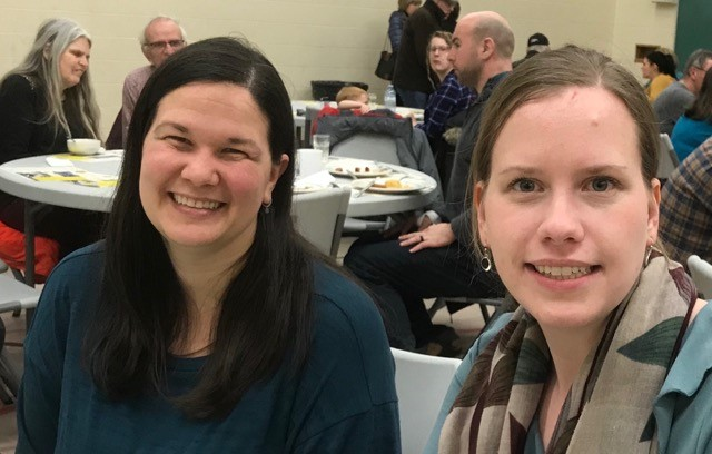 Anna Marchand and a friend at the Shrove Tuesday dinner.